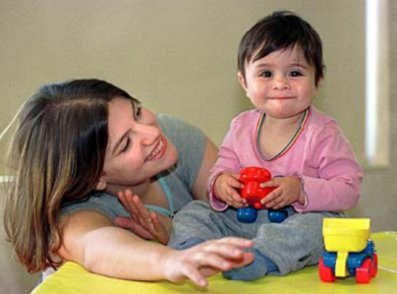 baby and caregiver with toys