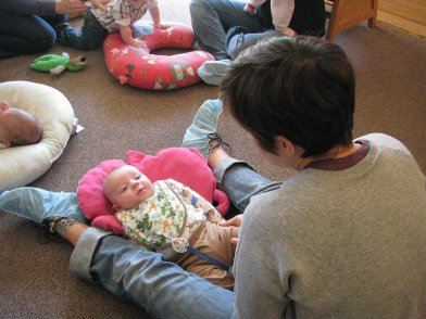 caregiver interacting with infant