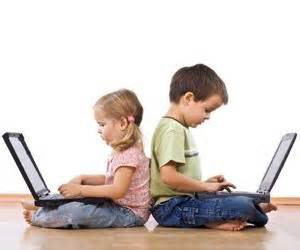 Children engaged with computers