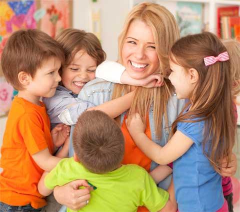 teacher hugging kids