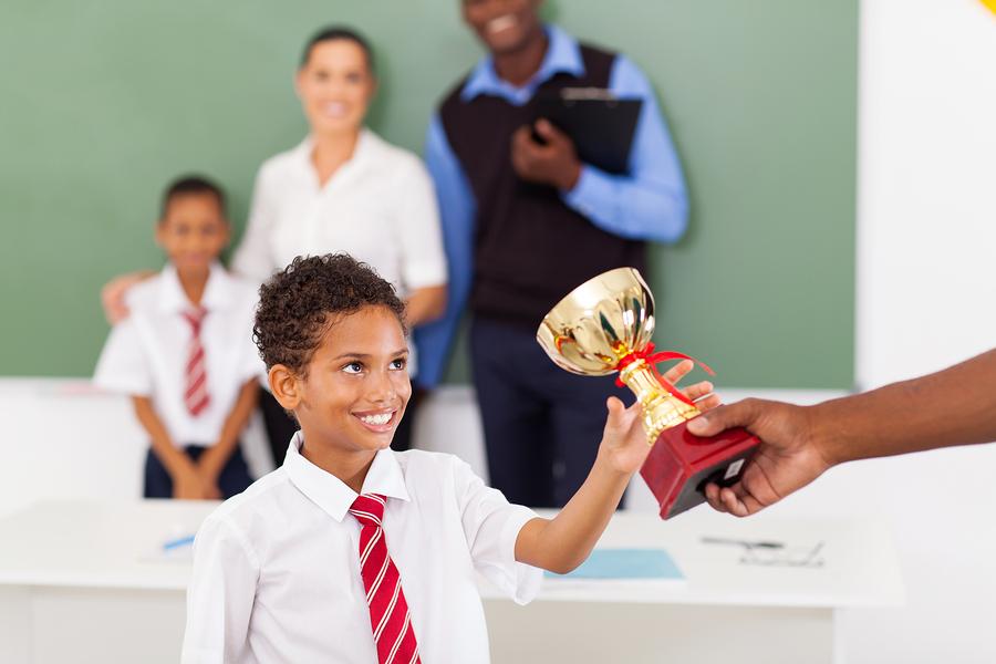 bigstock-elementary-school-boy-receivin-43149382.jpg