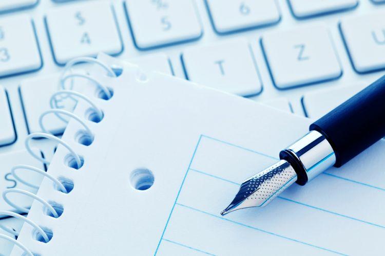 bigstock-Notepad-and-keyboard-of-a-comp-23284547.jpg
