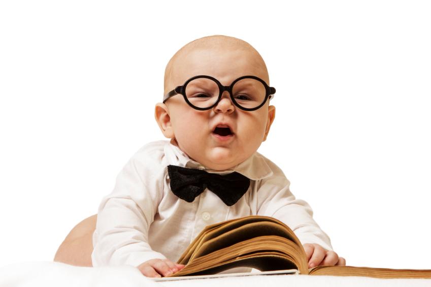 Cute baby reading stock photo
