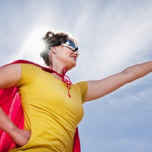 hero woman red cape blue sky