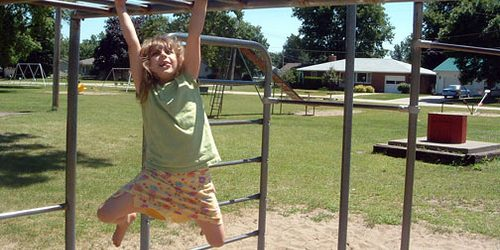 girl on monkey bars 500x250