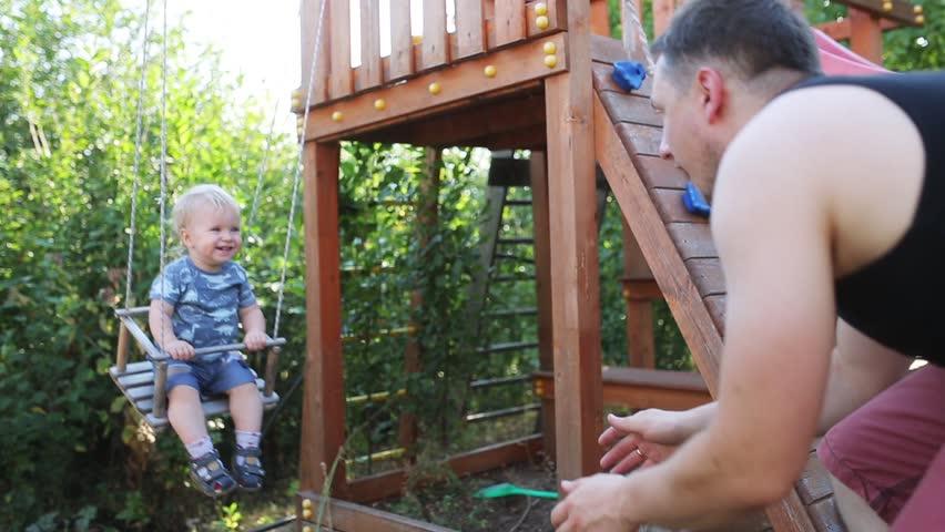 pushing baby on swing