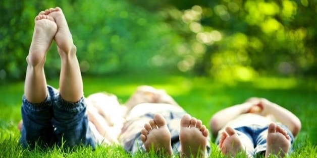 children relaxing in grass 628x419 min 1